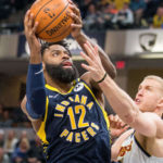 ndiana Pacers guard Tyreke Evans (12) shoots the ball while Denver Nuggets forward Mason Plumlee (24) defends in the second half at Bankers Life Fieldhouse.