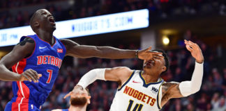 The left hand of Detroit Pistons forward Thon Maker (7) hits Denver Nuggets guard Gary Harris (14) after an attempted shot in the first quarter at the Pepsi Center.