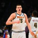 Denver Nuggets center Nikola Jokic (15) reacts after scoring in the second half against the Detroit Pistons at the Pepsi Center.