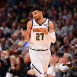 Denver Nuggets guard Jamal Murray (27) reacts after scoring a three point basket in the second half against the Detroit Pistons at the Pepsi Center.