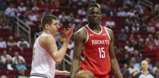 Denver Nuggets center Nikola Jokic (15) and Houston Rockets center Clint Capela (15) react after a play during the first quarter at Toyota Center.