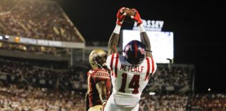 Mississippi Rebels wide receiver D.K. Metcalf (14) catches a touchdown pass as Florida State Seminoles defensive back Tarvarus McFadden (4) defends in the second quarter at Camping World Stadium.