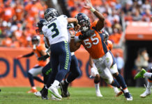 Denver Broncos outside linebacker Bradley Chubb (55) hurries Seattle Seahawks quarterback Russell Wilson (3) in the second quarter at Broncos Stadium at Mile High.
