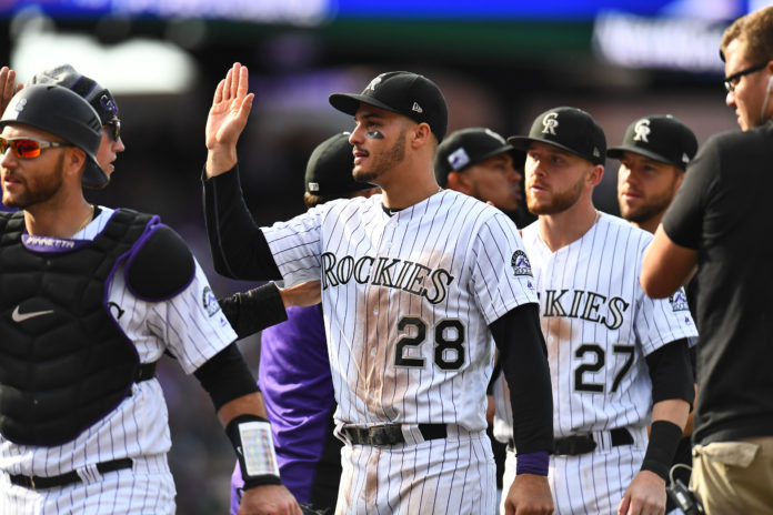 Colorado Rockies third baseman Nolan Arenado (28) celebrates after a win against the Washington Nationals at Coors Field.