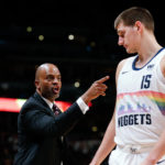 Denver Nuggets assistant coach Wes Unseld Jr. talks with center Nikola Jokic (15) in the fourth quarter against the Houston Rockets at the Pepsi Center.