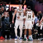 Denver Nuggets guard Gary Harris (14) talks with center Nikola Jokic (15) after he receives a double technical foul and is ejected in the fourth quarter against the Washington Wizards at the Pepsi Center.