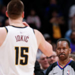 Denver Nuggets center Nikola Jokic (15) argues a call with referee James Capers (19) and is ejected on a double technical foul in the fourth quarter against the Washington Wizards at the Pepsi Center.