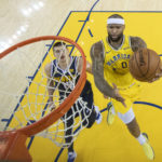 Golden State Warriors center DeMarcus Cousins (0) shoots the basketball against Denver Nuggets center Nikola Jokic (15) during the first half at Oracle Arena.