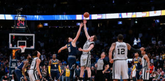 San Antonio Spurs center Jakob Poeltl (25) wins the tip off against Denver Nuggets center Nikola Jokic (15) in the first quarter at the Pepsi Center