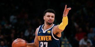 Denver Nuggets guard Jamal Murray (27) motions as he dribbles the ball up court in the second quarter against the San Antonio Spurs at the Pepsi Center.