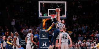 Denver Nuggets guard Malik Beasley (25) dunks the ball against San Antonio Spurs forward Drew Eubanks (14) as forward Dante Cunningham (33) and forward Davis Bertans (42) watch in the fourth quarter at the Pepsi Center.