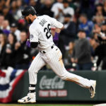 Colorado Rockies left fielder David Dahl (26) runs the bases after hitting a solo home run in the fourth inning against the Los Angeles Dodgers at Coors Field.