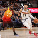 Denver Nuggets guard Jamal Murray (27) dribbles the ball around Utah Jazz forward Royce O'Neale (23) during the first quarter at Vivint Smart Home Arena.