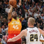 Utah Jazz guard Donovan Mitchell (45) shoots the ball over Denver Nuggets forward Mason Plumlee (24) during the fourth quarter at Vivint Smart Home Arena. Utah Jazz won 118-108.
