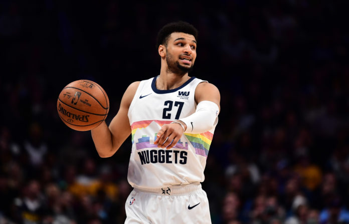 Denver Nuggets guard Jamal Murray (27) provides direction in the second quarter against the Minnesota Timberwolves at the Pepsi Center.