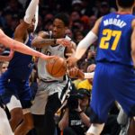 Denver Nuggets center Nikola Jokic (15) and forward Paul Millsap (4) and guard Gary Harris (14) defend San Antonio Spurs guard DeMar DeRozan (10) in the second quarter of the first round of the 2019 NBA Playoffs at Pepsi Center.