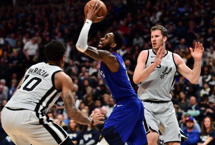 Denver Nuggets guard Will Barton (5) shoots over San Antonio Spurs guard DeMar DeRozan (10) in the second quarter of the first round of the 2019 NBA Playoffs at Pepsi Center.