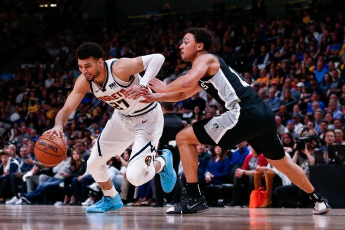 Denver Nuggets guard Jamal Murray (27) controls the ball as San Antonio Spurs guard Bryn Forbes (11) defends in the second quarter in game two of the first round of the 2019 NBA Playoffs at the Pepsi Center.