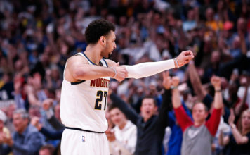 Denver Nuggets guard Jamal Murray (27) reacts after a play against the San Antonio Spurs in the fourth quarter in game two of the first round of the 2019 NBA Playoffs at the Pepsi Center.