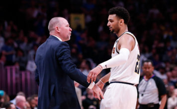Denver Nuggets head coach Michael Malone reacts with guard Jamal Murray (27) in the fourth quarter against the San Antonio Spurs in game two of the first round of the 2019 NBA Playoffs at the Pepsi Center.