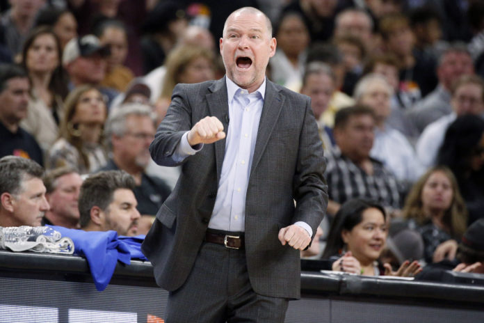 Denver Nuggets head coach Michael Malone reacts against the San Antonio Spurs in game three of the first round of the 2019 NBA Playoffs at AT&T Center.