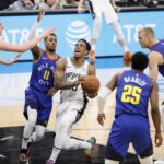 San Antonio Spurs shooting guard DeMar DeRozan (10) drives for the basket between Denver Nuggets point guard Monte Morris (11) and Malik Beasley (25) in game four of the first round of the 2019 NBA Playoffs at AT&T Center.