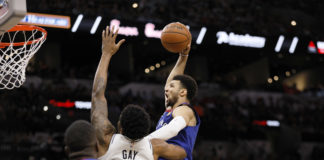 Denver Nuggets point guard Jamal Murray (27) dunks the ball over San Antonio Spurs small forward Rudy Gay (22) in game four of the first round of the 2019 NBA Playoffs at AT&T Center.