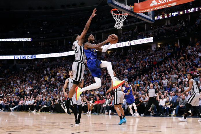 Denver Nuggets guard Will Barton (5) drives to the net against San Antonio Spurs forward Rudy Gay (22) in the second quarter at the Pepsi Center.