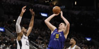 Denver Nuggets center Nikola Jokic (15) shoots the ball over San Antonio Spurs power forward LaMarcus Aldridge (12) in game six of the first round of the 2019 NBA Playoffs at AT&T Center.