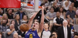 Denver Nuggets center Nikola Jokic (15) dunks the ball against the San Antonio Spurs in game six of the first round of the 2019 NBA Playoffs at AT&T Center.