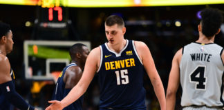 Denver Nuggets center Nikola Jokic (15) during the first half against the San Antonio Spurs in game seven of the first round of the 2019 NBA Playoffs at the Pepsi Center.