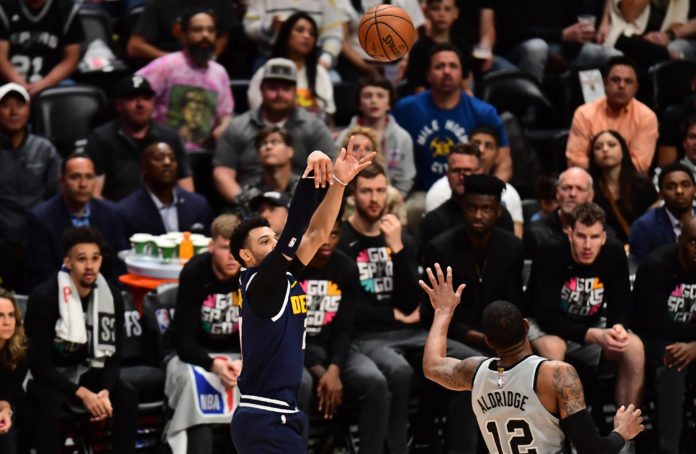 Denver Nuggets guard Jamal Murray (27) shoots over San Antonio Spurs center LaMarcus Aldridge (12) in the fourth quarter in game seven of the first round of the 2019 NBA Playoffs at the Pepsi Center.