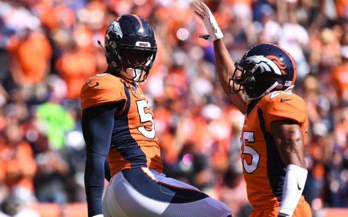Chris Harris and Von Miller celebrate. Credit: Ron Chenoy, USA TODAY Sports.