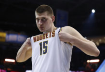 Denver Nuggets center Nikola Jokic (15) adjust his jersey during the second half against the Oklahoma City Thunder at Chesapeake Energy Arena. Denver won 115-105.