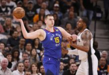 Denver Nuggets center Nikola Jokic (15) looks to pass against San Antonio Spurs power forward LaMarcus Aldridge (right) in game six of the first round of the 2019 NBA Playoffs at AT&T Center.
