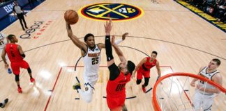 Denver Nuggets guard Malik Beasley (25) drives to the net against Portland Trail Blazers center Enes Kanter (00) as guard CJ McCollum (3) and center Nikola Jokic (15) look on in the third quarter in game two of the second round of the 2019 NBA Playoffs at the Pepsi Center.