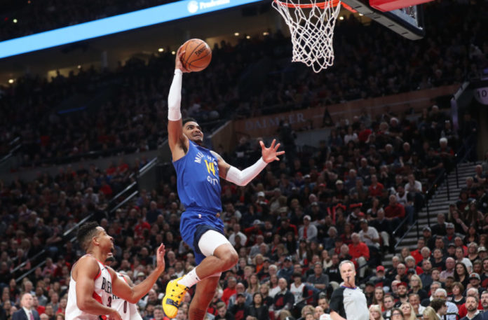Denver Nuggets guard Gary Harris (14) dunks over Portland Trail Blazers in the first half of game three of the second round of the 2019 NBA Playoffs at Moda Center.