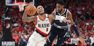 Portland Trail Blazers guard Damian Lillard (0) drives against Denver Nuggets guard Will Barton (5) in the second half of game four of the second round of the 2019 NBA Playoffs at Moda Center.