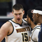 Denver Nuggets center Nikola Jokic (15) reacts following a score with guard Jamal Murray (27) and forward Torrey Craig (3) in the second quarter against the Portland Trail Blazers in game five of the second round of the 2019 NBA Playoffs at Pepsi Center.