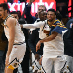 Denver Nuggets forward Juan Hernangomez (41) reacts to his successful three-point basket with guard Jamal Murray (27) in the fourth quarter against the Portland Trail Blazers in game five of the second round of the 2019 NBA Playoffs at Pepsi Center.