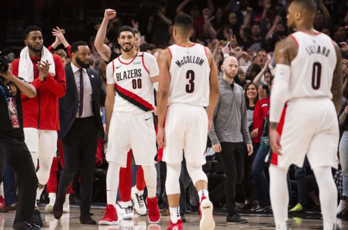Portland Trail Blazers center Enes Kanter (00) celebrates with teammates after the game against the Denver Nuggets in game six of the second round of the 2019 NBA Playoffs at Moda Center.