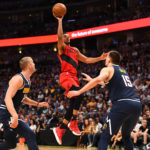 Portland Trail Blazers guard CJ McCollum (3) shoots over Denver Nuggets forward Mason Plumlee (24) and center Nikola Jokic (15) in the second quarter in game seven of the second round of the 2019 NBA Playoffs at Pepsi Center.
