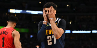 Denver Nuggets guard Jamal Murray (27) reacts in the second quarter against the Portland Trail Blazers in game seven of the second round of the 2019 NBA Playoffs at Pepsi Center.