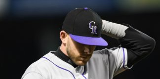 Trevor Story leaves due to injury in the 9th inning. Credit: Michael Fluharty, USA TODAY Sports.