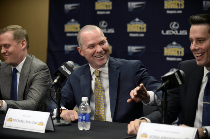 Denver Nuggets head coach Michael Malone (center), general manager GM Tim Connelly (left) and president Josh Kroenke (right) react to a media question during a press conference at the Pepsi Center.
