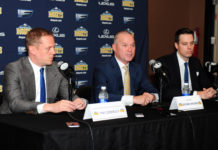 Denver Nuggets head coach Michael Malone (center) and general manager GM Tim Connelly (left) and president Josh Kroenke (right) during a press conference at the Pepsi Center.