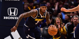 Denver Nuggets forward Torrey Craig (3) drives with the ball in the second half against the Utah Jazz at the Pepsi Center.