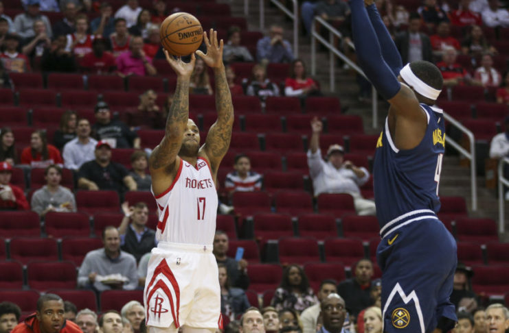 Houston Rockets forward PJ Tucker (17) shoots the ball against Denver Nuggets forward Paul Millsap (4) during the first quarter at Toyota Center.