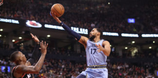 Memphis Grizzlies forward Garrett Temple (17) drives to the basket against Toronto Raptors guard Delon Wright (55) in the first quarter at Scotiabank Arena. The Raptors be