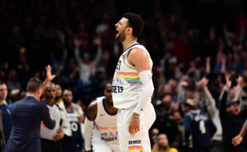 Denver Nuggets guard Jamal Murray (27) reacts after his three point basket in the fourth quarter against the Minnesota Timberwolves at the Pepsi Center.